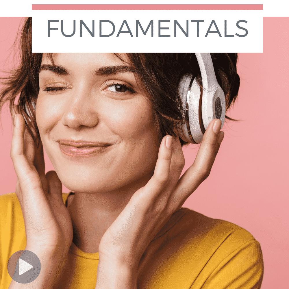 woman listening to nursing fundamentals quiz on headphones