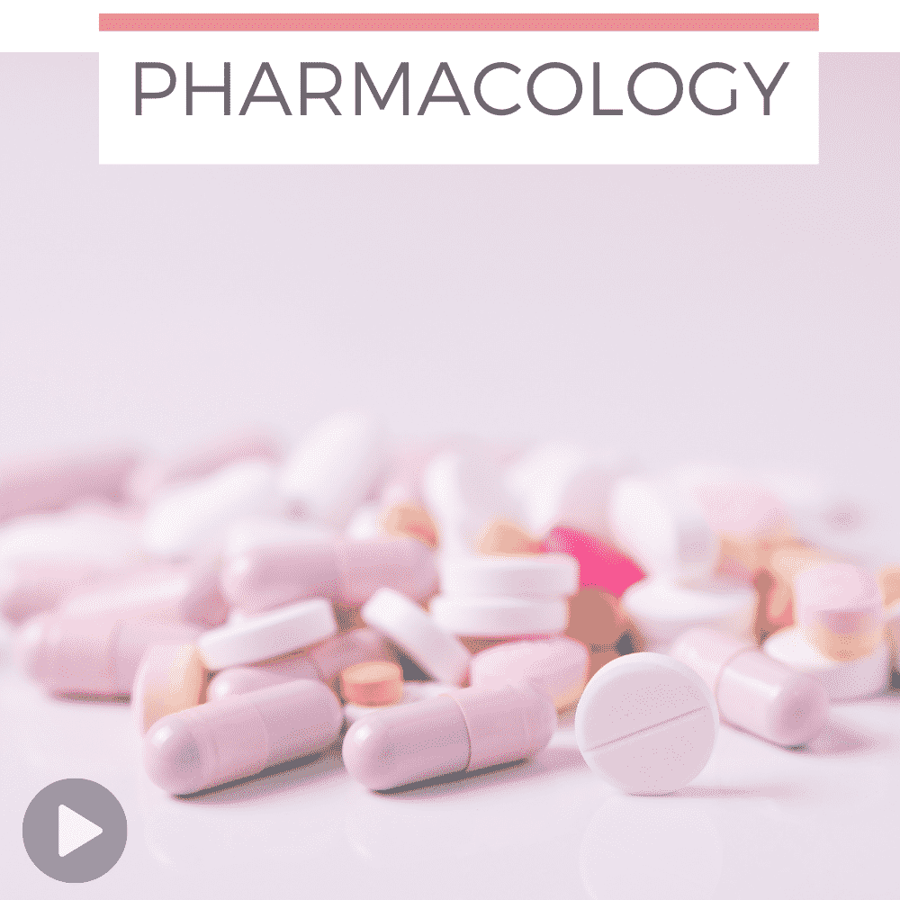 scattered pills on pink background